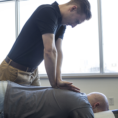 Chiropractor giving man adjustment